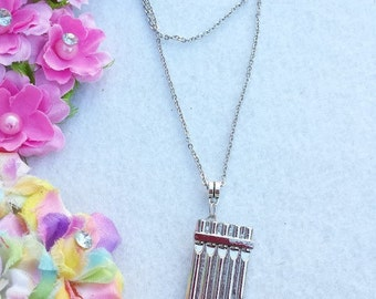 Peter Pan's Flute Necklace.