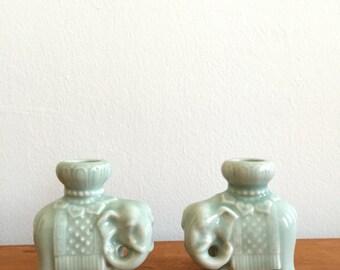 mid century boho elephant candlestick holders. hollywood regency good luck elephant candle holders. home interior design candlestick holders