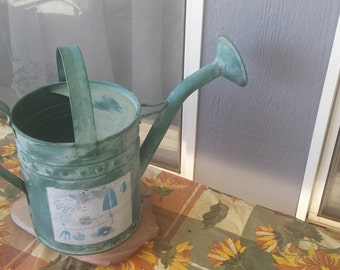 Vintage watering can with spout and two handles great for potted plants.