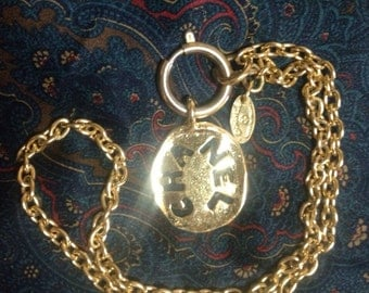 Vintage CHANEL Golden logo charm chain necklace. Chanel coin charm is the accent and make you give the CHANEL look.