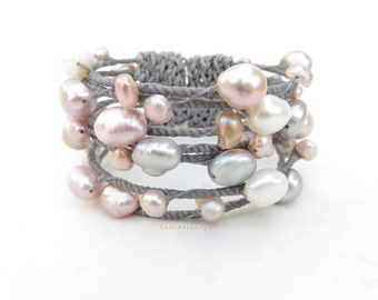 White gray pink freshwater pearl with wrapped gray wax cord on wire bangle