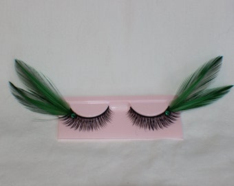 Green and black feather lashes with green jewels