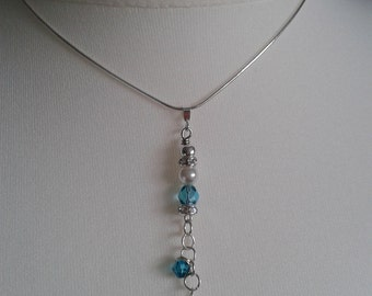 Aquamarine crystal pendant on smooth sterling silver chain.