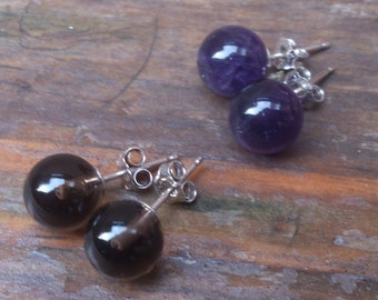 Two pairs of gemstone stud earrings, smoky quartz and amethyst