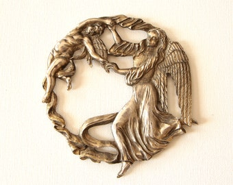 Pewter trivet paper weight cherub and angel made by Metzke
