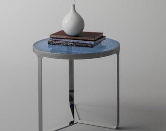Modern Side table. Chrome side table with blue glass top and distinctive, modern look