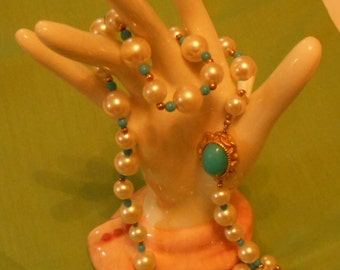 Twenty-four inch costume necklace made of aqua and gold rondelles and faux pearls. (263)