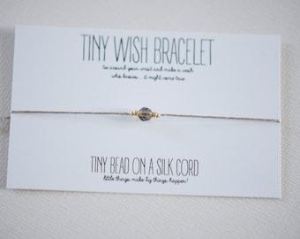 Silk cord bracelet with smokey quartz gemstone bead on silk cord