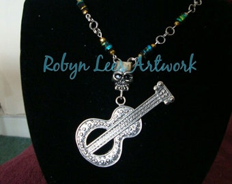 Silver Guitar Skull Undead Necklace with Turquoise and Gold Sprayed Beads