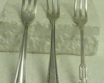 3 Sterling Silver Lemon Forks ( 1 Monogrammed ) & Olive Spoon.