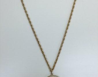large gold zodiac pendant necklace Napier 70s