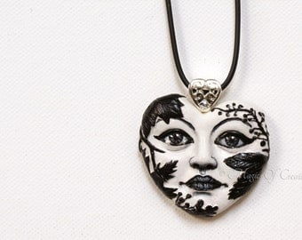Black and white heart pendant, hand painted cast sculpture realized as a mysterious and elegant art necklace!