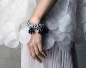 ATOMIC hematite statement bracelet in dark grey silver colour