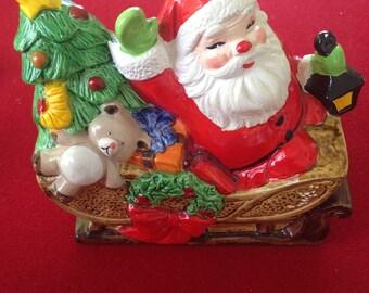 Vintage Ceramic Santa on Sleigh Figurine
