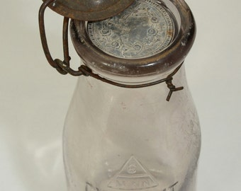 VINTAGE MILK BOTTLE, with a metal and wire top and a rare metal insert
