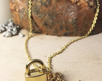 dainty gold lock and key charm necklace
