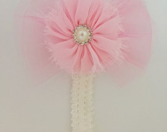 Cream hairband with a soft pink flower and tulle