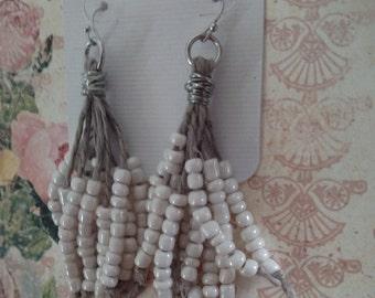 Handmade earrings with ecru beads and cord