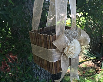 custom rustic woodland flower girl basket with cream  bows  and sola flower destination wedding basket