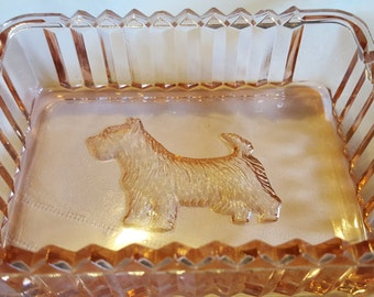 Pink art deco glass dish.  Featuring sawtooth edging and Scottish terrier dog.