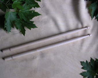 Pair of drumsticks, handturned in hard maple with decorative burnt lines
