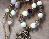 Vintage Buddhist Pendant Necklace The 4 Friends with vintage fluorite, pale green jade, and African brass