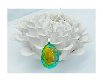 Kiln fused glass teardrop shaped necklace in light turquoise, yellow, and lavender