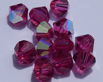 Close Out! Fuchsia Pink Swarvoski Crystal, 4 mm, Bi-Cone, AB Finish, Pkg of 12