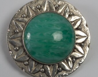 Antique Arts and Crafts silver plated brooch with green glass cabochon
