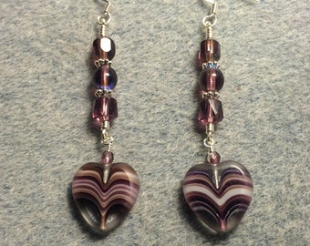 Purple Czech glass heart bead dangle earrings adorned with purple Czech glass beads.