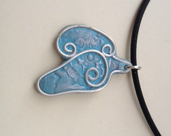 Silver and polymer clay horse head pendant.