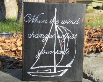 When the wind changes adjust your sails.sign