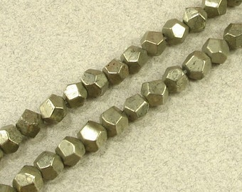 FACETED PYRITEnugget beads  16 inch strand
