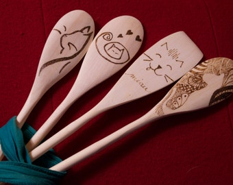 Crazy-cat-lady style woodburned wooden spoons.