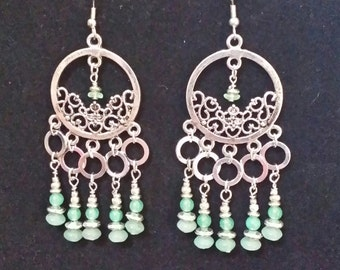 Silver chandelier earrings with jade-green beads