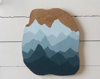Teak wood sign with painting of mountains