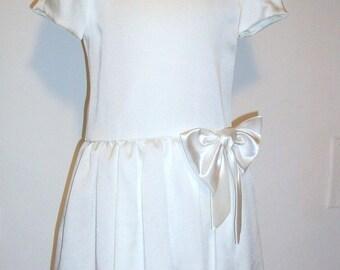 wedding gown in silk .