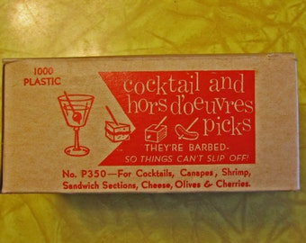 Vintage coctail picks, green red white pink and yellow, still in origional box, between 750-1,000, 1960's