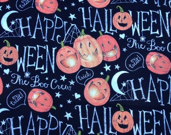 Springs Creative Halloween Pumpkins on black background fabric