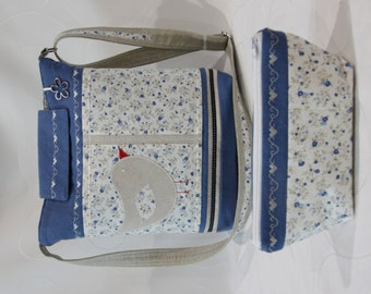 Shoulder bag with bird including cosmetic bag