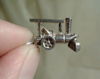 A sterling silver moving steamroller charm