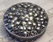 Lovely antique Victorian Sterling Silver Pill Box With a Raised Floral Repousse Cover and Etched Sides Dated 1887