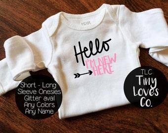 hello im new here. hello world. baby name onesie. new baby onesie. coming home outfit. going home outfit. baby girl. baby boy. hello onesie