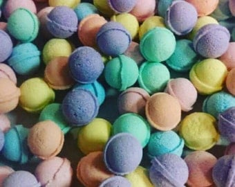 Bath bombs! Mini all natural Bath bombs by the pound. Assorted mini Bath bombs. Bath Bomb favors bath bomb gift sets. We love to customize!