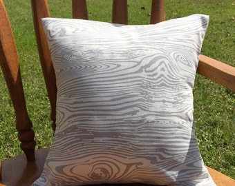 Gray woodgrain nursery pillow