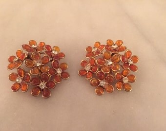 Vintage amber colored plastic flower rhinestone earrings