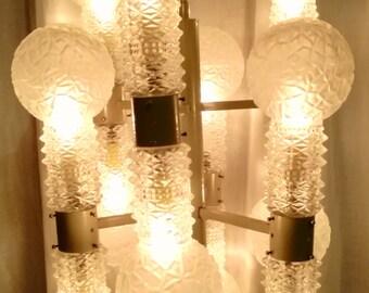 Nason Mazzega chandelier 12 luci 12 paraluce in cristallo lampadario brutalist chandelier space age sputnik Made in Italy 1960s