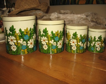 Set of 4 boxes of kitchen beige has flower garden pattern. Organization and storage, boxes and bins, metal boxes.