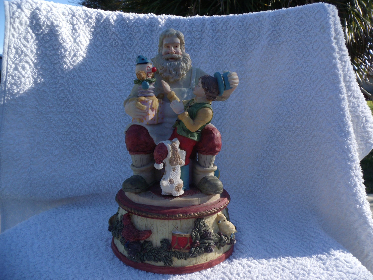 Music box figurine of santa claus with boy on his knee and toy
