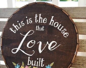 This is the House that Love Built-Round Wooden Sign